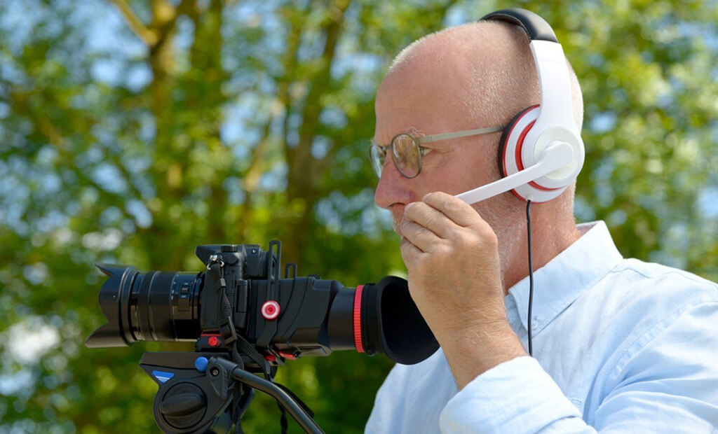 videographer using headset with camera