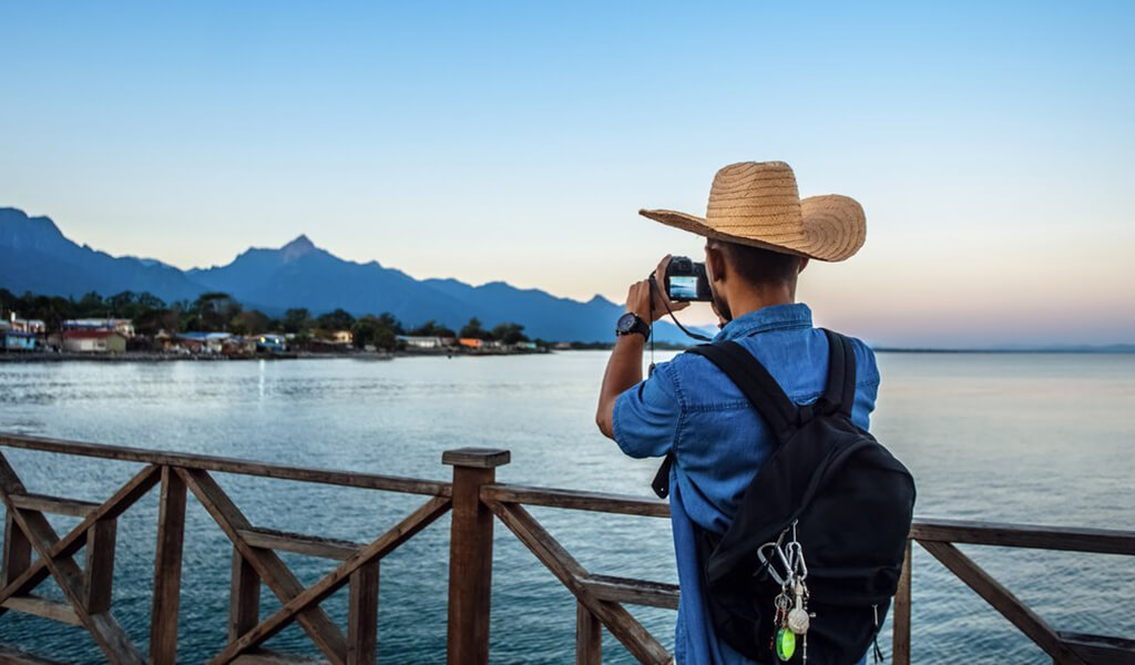 Traveller with backpack taking picture